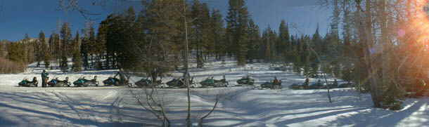 Snowmobiling along a Lake Tahoe Trail