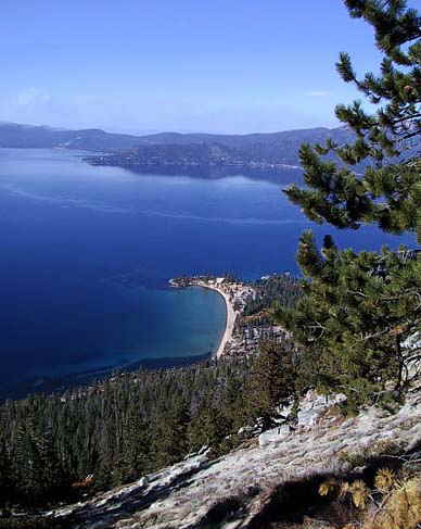 Lake Tahoe beaches are accessible to Accommodation Tahoe guests on foot just across the highway from Lake Village.