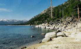 Lake Tahoe water front has a combination of sand and rock that offers beach combers interest